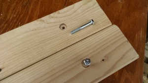 wood with bolt holes